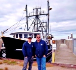 Jeremy Reposa  (lft) and his father Peter stand between docks G&H at the Port of Galilee. (photo Tracey C. O'Neill)