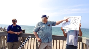 Multiple environmental agencies participated in volunteer beach profiling training led by Dr. Jon Boothroyd, Professor Emeritus, URI. Boothroyd explains changes seen at South Kingstown Town Beach over the past decade. (Photo credit Tracey C. O'Neill)