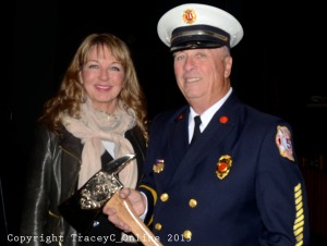 040215 Hagan-McEntee Carol and Munson Hilding. Hilding Munson Ret. Capt. Station 5, Snug Harbor lends his axe to RI District 33 Candidate Carol Hagan-McEntee at the Union Fire District Awards Night in April.  Munson received the Distinguished Service record for his 54 years of service with the department.