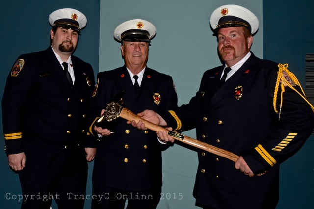 040215 Pastore Munson Schofield UFD Station 5. Capt. John Pastore (left) joins Ret. Capt. Hilding Munson (center) and Lt. Peter Schofield after receiving his Distinguished Service award. The department presented Munson, who serves as Snug Harbor FD president, a brass-plated axe for his years of service.