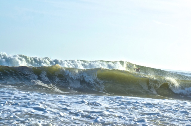 A surfer takes advantage of the ocean swell in South Kingstown on Monday. (Photo Tracey C. O'Neill)