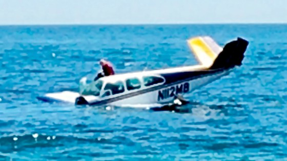 A small plane crashed into the waters off Weekapaug Beach on Saturday morning. The pilot and sole passenger was rescued by ocean lifeguards and transported to RI Hospital. (Photo: Courtesy residents on scene)