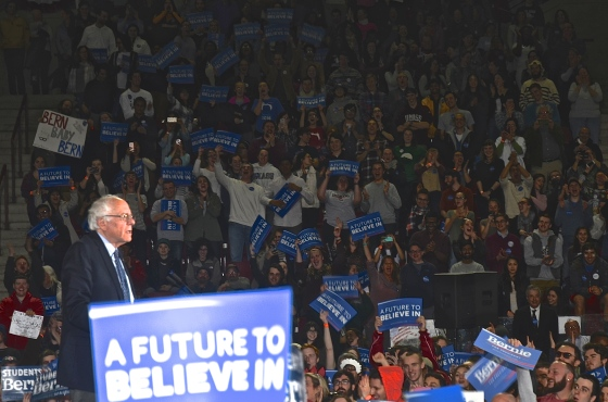 Democratic Presidential Candidate U.S. Sen. Bernie Sanders pauses as a crowd of supporters at UMASS Amherst cheer. (Photo Tracey C. O'Neill)