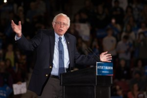 "Sen. Bernie Sanders talks middle class issues. ""Enough is enough,"" he said of Wall Street Politics. Sanders drew thousands of supporters at the UMASS Amherst Mellon Center on Monday. Photo by Matthew Cavanaugh/Getty Images"