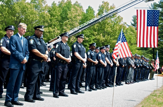 Boston PD Commissioner William Evans stands BPD officers at the funeral services of fallen Auburn Police Officer Ronald Tarantino, Jr. in May 2016.